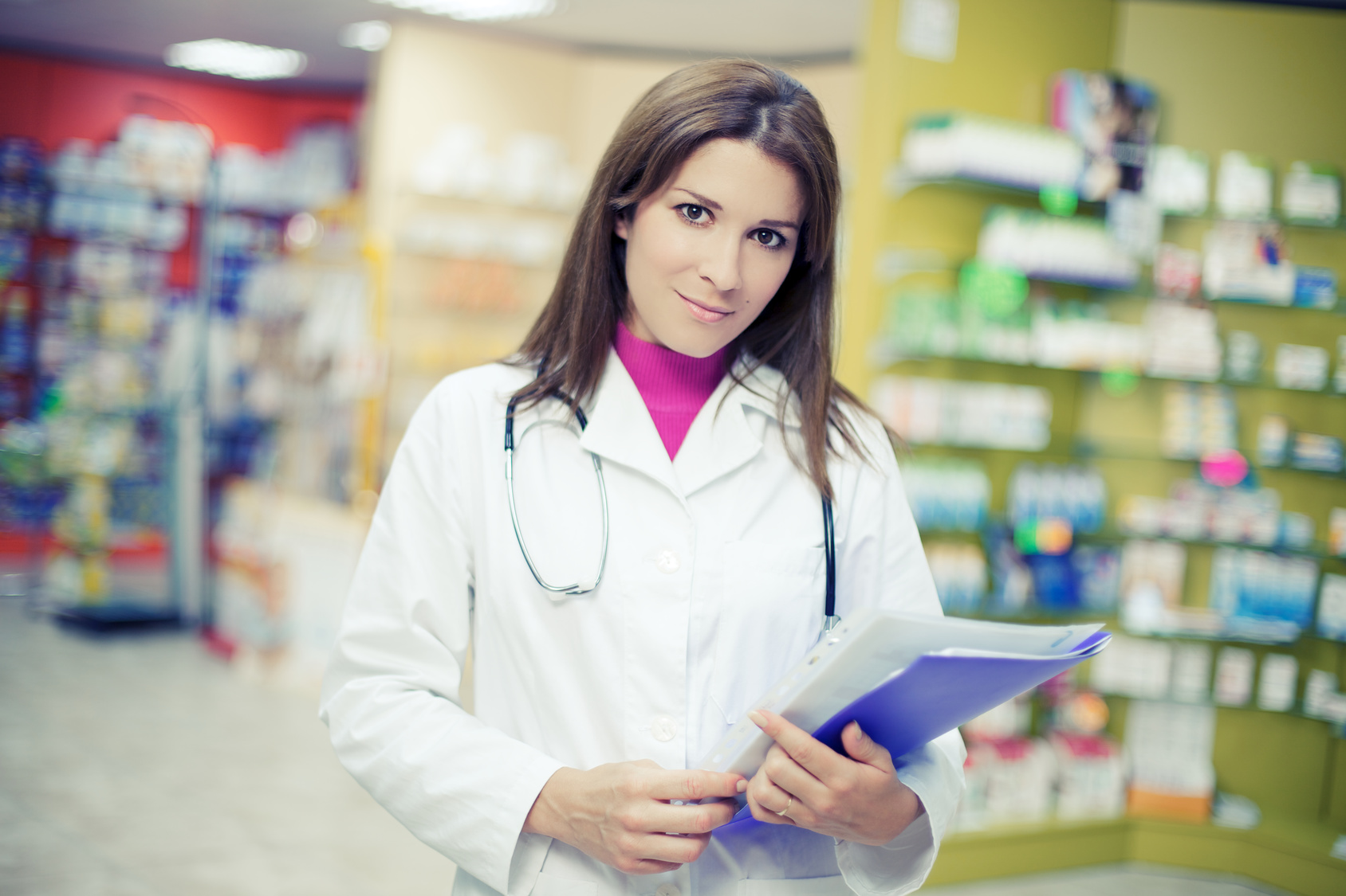 Happy woman pharmacist serious working